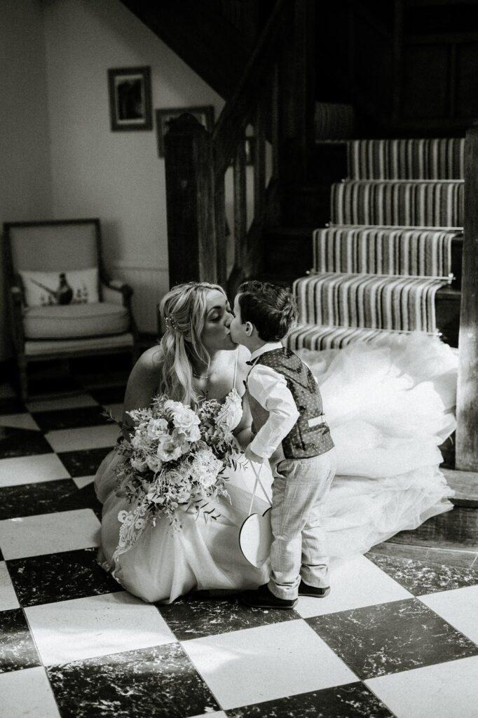 Bride kisses little boy