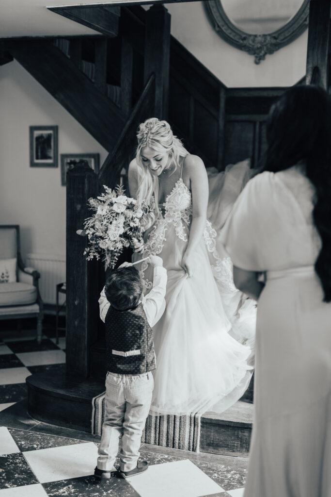 Little boy greets bride at Hayne House