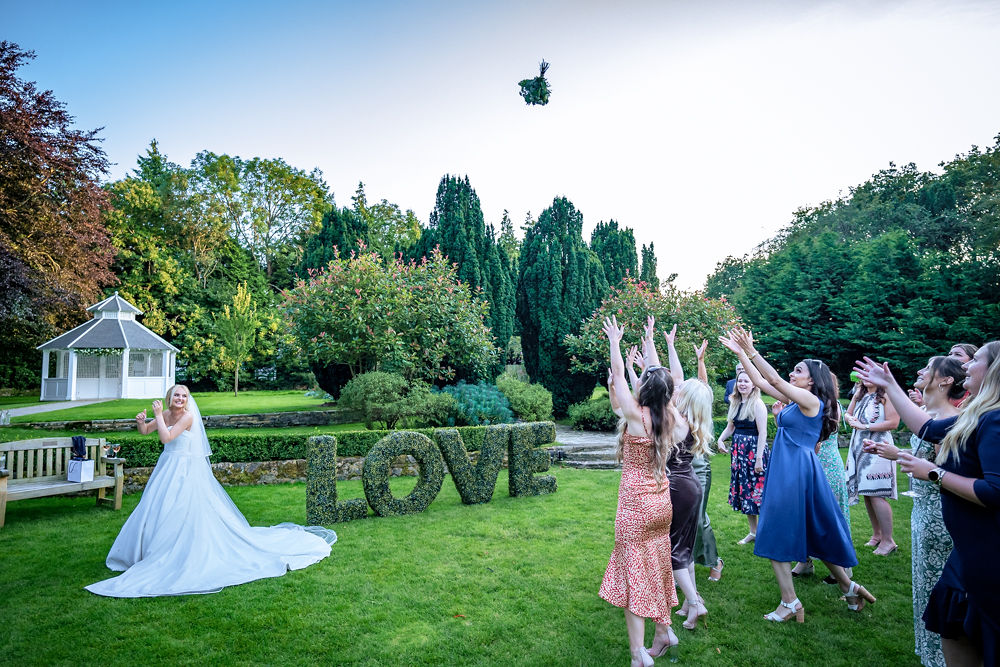 Bride throws bouquet at Hayne House