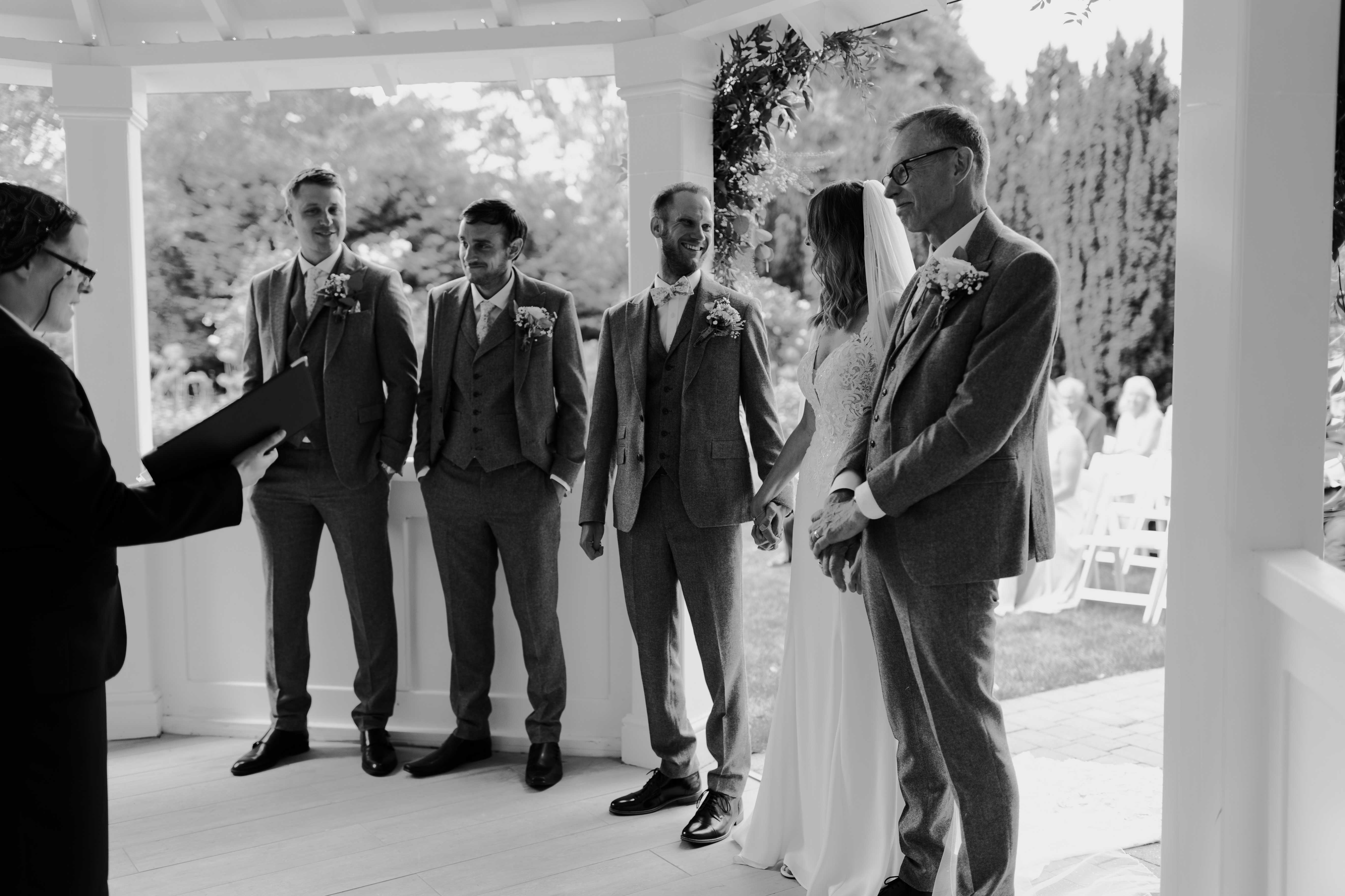 Couple getting married surrounded by groom's party at Hayne House