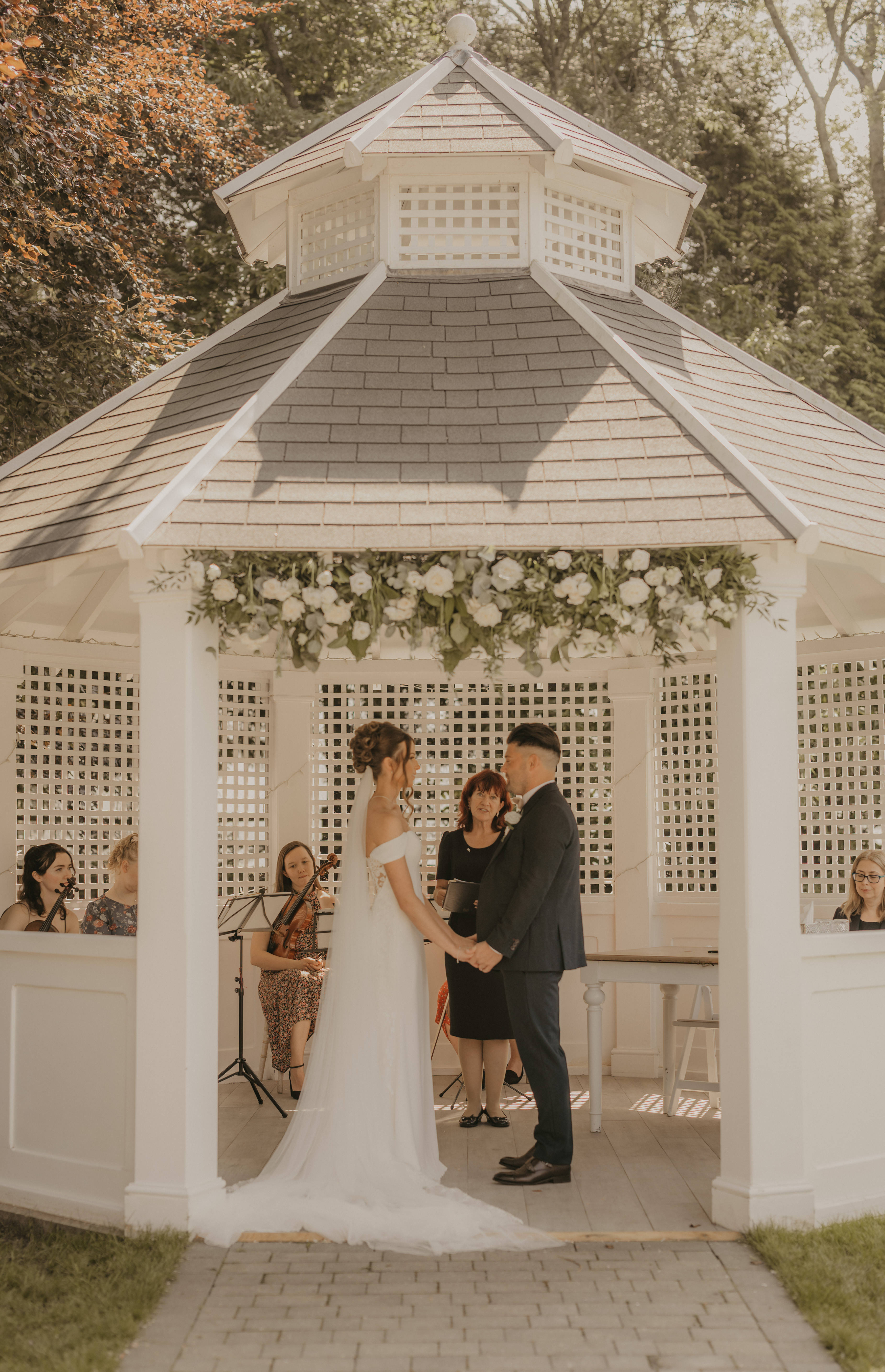 Couple getting married in Pavilion at Hayne House